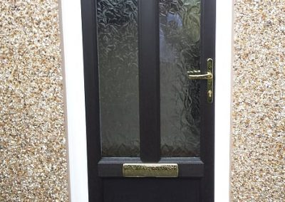 Black door with obscure glass