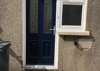 Blue Fibreglass composite door with side screen
