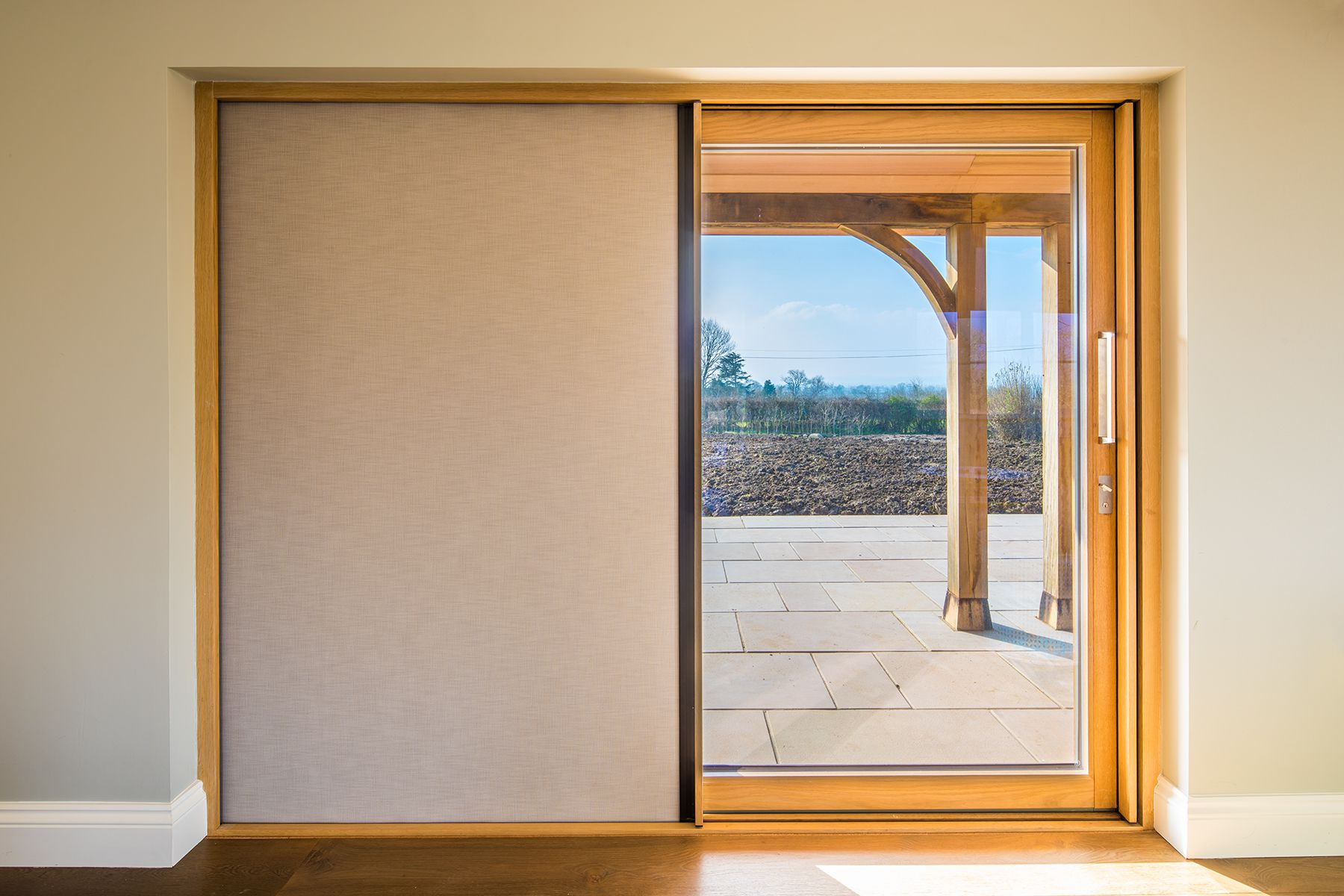 centor sliding door oak inside, aluminium outside. With black outblind