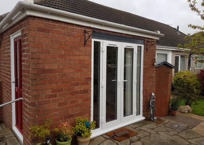 Modus slim sash french doors wih trickle vents and side screens