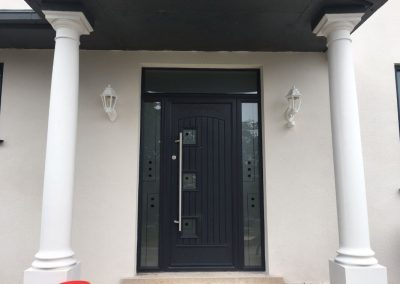 Anthracite Grey Fibreglass composite door with side screens and toplight. Pull bar handle