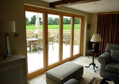 Aluminium and oak bi fold doors