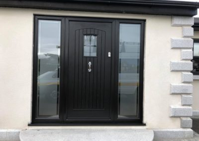 black fiberglass door with sidescreens and doctors knocker