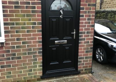 Black fiberglass composite door