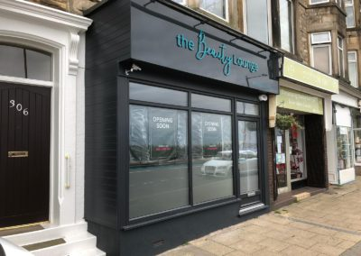 anthracite grey shop front with laminate glass and secure by design locking for extra security