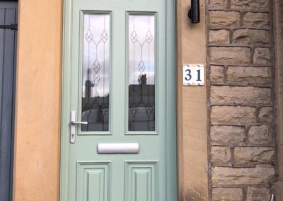 Chartwell Green Fiberglass composite door with toplight