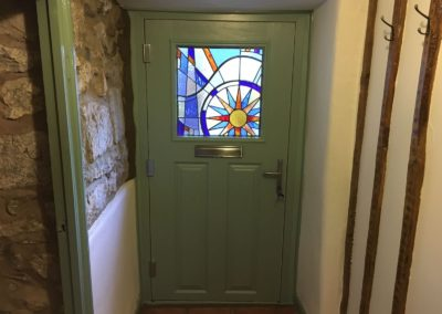 composite door with specially commissioned glass