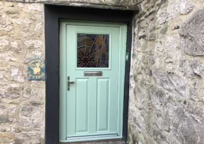 Chartwell Green composite door with customised glass