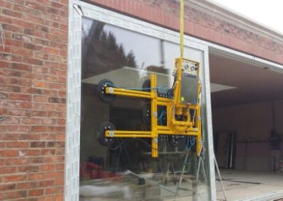 Lift and slide door installation with crane