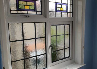UPVC A rated window with encapsulated leaded lights