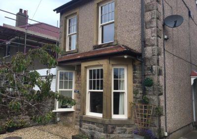 cream sliding sash with astrical bar in top lights