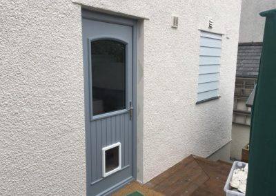 silver grey fiberglass back door with dog flap