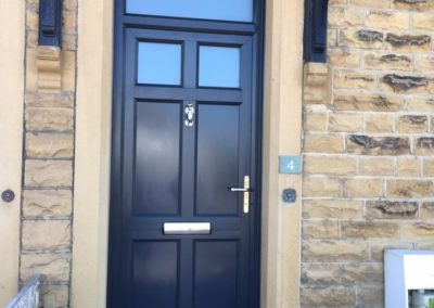 Smooth grey door with toplight