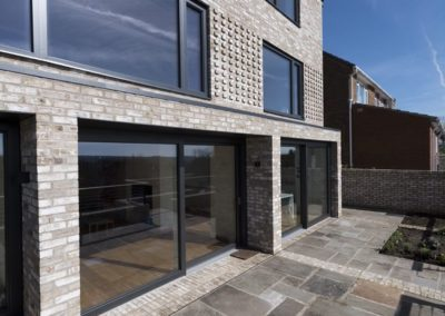 anthracite grey lift and slide aluminium timber doors