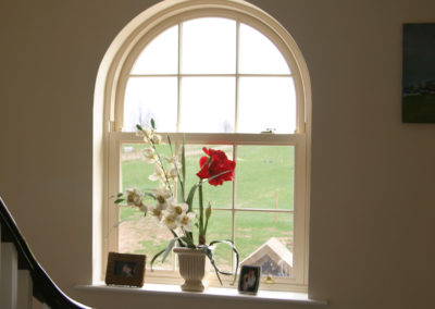 Arched vertical sliding sash window